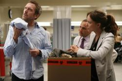 House (Hugh Laurie, L), Olivia Wilde (R) and Peter Jacobson (C)