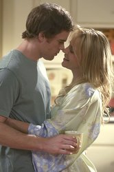 Michael C. Hall as Dexter and Julie Benz as Rita
