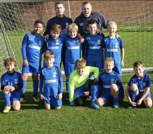 Club Langley JFC youth team infront of football nets