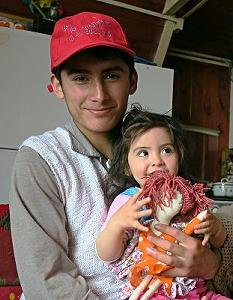 Olga her big brother Victor and the doll that Paula made