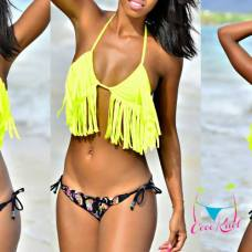 Coco K'nel Bikini - Martinique Coco K'nel Bikini is made in paradise for the bold, carefree, confident woman. Their designs are a mix of patterned and solid print, that are great for lounging or liming. Photo Courtesy of Lory Coat via Coco K'nel Bikini/Facebook