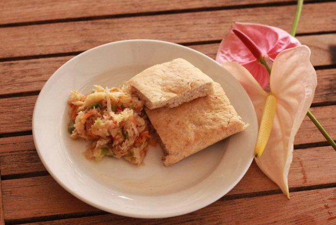 Saltfish & Coconut Bakes Island: Grenada Saltfish and coconut bakes are a staple in Grenada. The saltfish is cooked with onions, shredded carrots and cabbage, and sautéed in a pan until cooked. Bake is a common breakfast bread that varies across certain islands. Grenadians add coconut milk and dry, grated coconut to give the bake extra flavor. Photo Courtesy of True Blue Bay