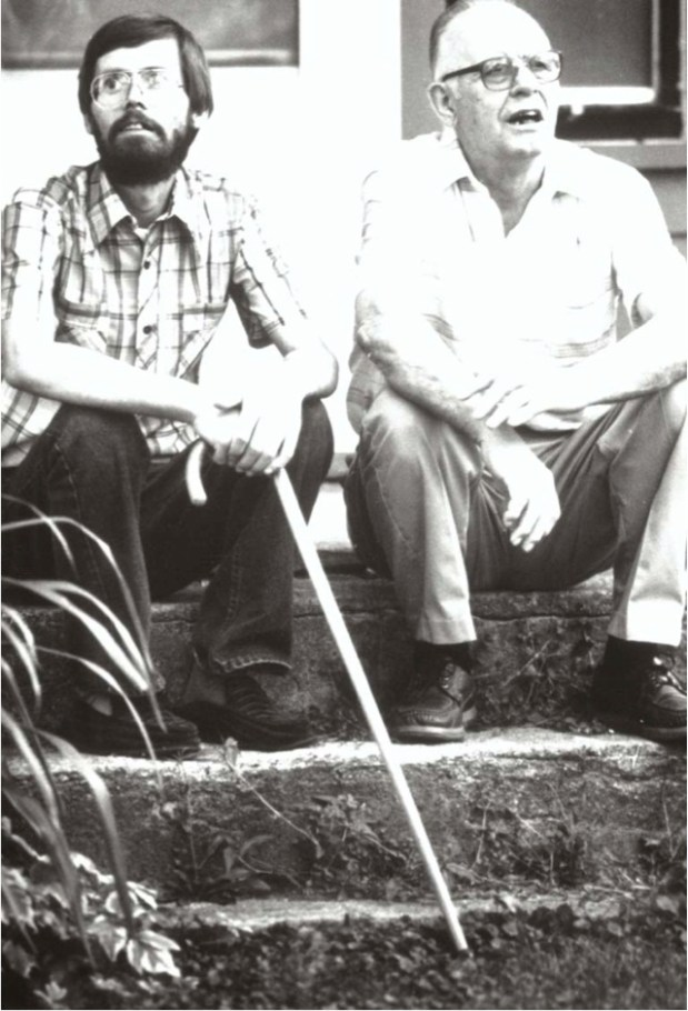 Dick Hanson, steadying himself with a cane, sits on the farmhouse stoop with his father, 69-year old Allen Hanson. The two shared life of farming, fishing and radical political activism. (Pioneer Press: Jean Pieri)
