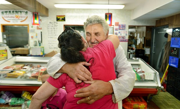 """Oh my God, I found you!"" said Sandy Amos of St. Paul, hugging 73-year-old butcher Stuart ""Stu"" Gerr at Stasny's Food Market in St. Paul on Wednesday May 16, 2012. ""Do you remember me? I used to get meat from you at the other place,"" said Amos. Gerr, who has revived his career at Stasny's, had previously cut meat at Capitol City Meats for 43 years. (Pioneer Press: Richard Marshall)"