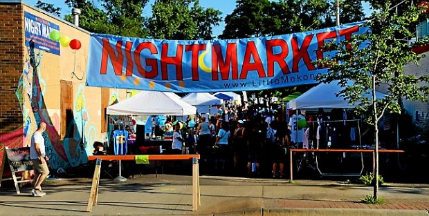 A banner announces the 'Night Market' in the Little Mekong section of University Avenue in St. Paul, Saturday, July 5, 2014. (Pioneer Press: John Autey)