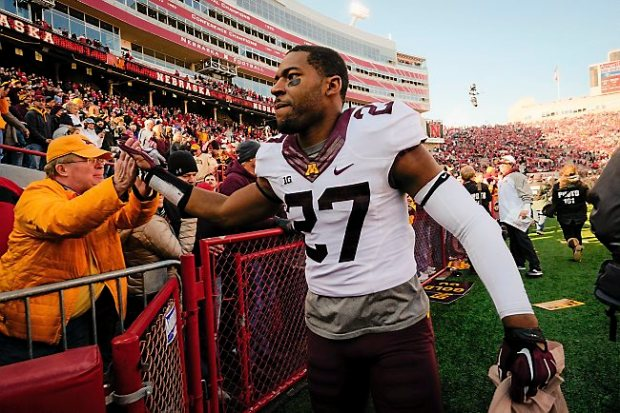 Gophers running back David Cobb gets congratulations from fans after Minnesota beat Nebraska 28-14 on Nov. 22, 2014, in Lincoln, Neb. (Photo by Eric Francis/Getty Images)