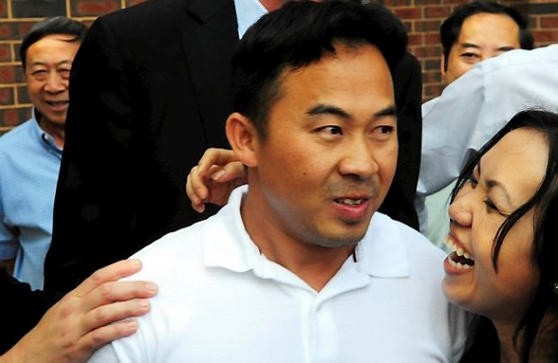 Koua Fong Lee, left, and his wife, Panghoua Moua, react after hearing that charges against him were dropped, on August 5, 2010. (Pioneer Press: Ben Garvin)