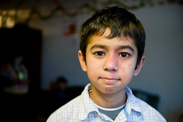 Bikram Phuyel, 11, of St. Paul, poses for a photo at home in St. Paul on Monday, January 26, 2015. Bikram was critically injured when he was struck by a car while walking to school at the end of October. (Pioneer Press: Ben Garvin)