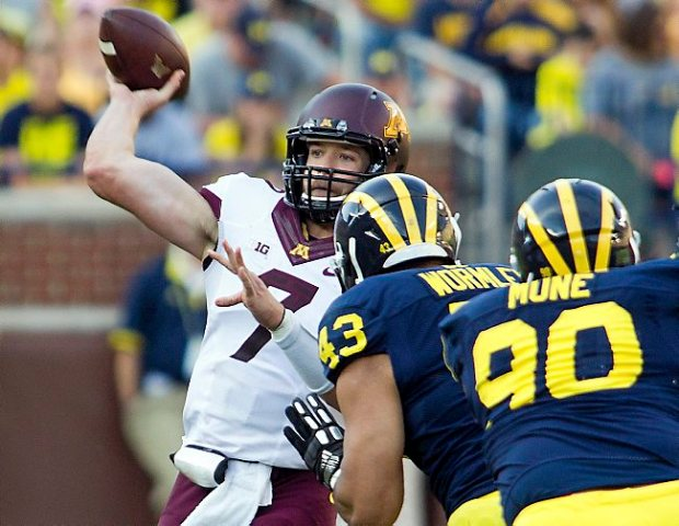 Minnesota quarterback Mitch Leidner throws a pass in the third quarter against Michigan in Ann Arbor, Mich. on Saturday, September 27, 2014. Minnesota won 30-14. (AP Photo/Tony Ding)