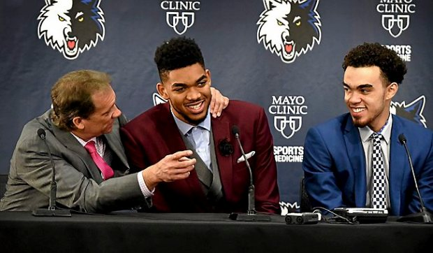 Timberwolves coach Flip Saunders, left, talks to No. 1 draft pick Karl-Anthony Towns, center, and fellow first-rounder Tyus Jones of Apple Valley during their press conference in Minneapolis on Friday, June 26, 2015. (Pioneer Press: Jean Pieri)
