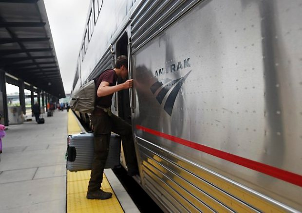 Jost Habbel of Germany boards Amtrak's Empire Builder train at Union Depot in St. Paul on July 16, 2015, to get back to his home country. (Pioneer Press: Holly Peterson)