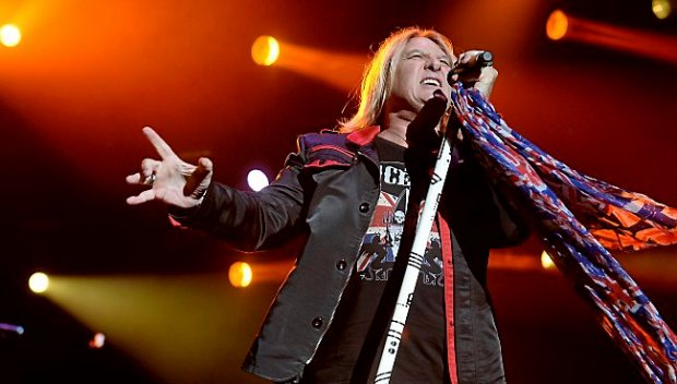 """Joe Elliott, lead singer for Def Leppard, performs the band's hit """"Rock! Rock! (Till You Drop)"""" at the Minnesota State Fair Grandstand in Falcon Heights, on Thursday, August 27, 2015. (Pioneer Press: John Autey)"""