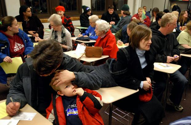 A crowd of Democratic-Farmer-Labor Party caucus-goers is asked to make room for arriving participants at Ramsey Junior High School in St. Paul in February 2008.
