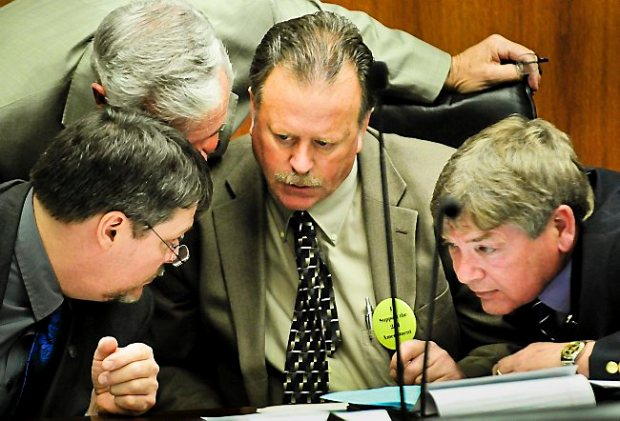 From left, Jim Newberger (R-Becker), Tony Cornish (R-Vernon Center), Mark Uglem (R-Champlin) and Brian Johnson (R-Cambridge) confer during testimony on day three of hearings on proposed gun legislation in the House Public Safety Committee at the State Office Building in St. Paul, Minn., on Thursday, February 7, 2013.(Pioneer Press: Ben Garvin)