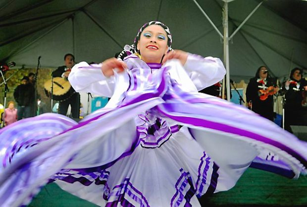 Mariachi bands and dancers in colorful costumes are hallmarks of the Cinco de Mayo fiesta. (Pioneer Press file: Ben Garvin)