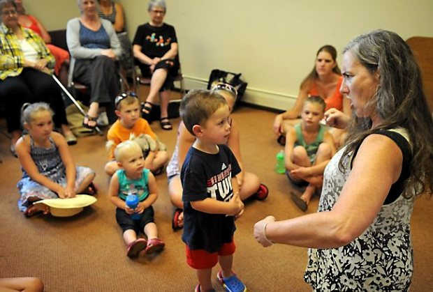 Danette Olsen, right, encourages Liam Banaszewski to act fierce during a creative drama workshop at the Lake Elmo Library Wednesday July 17, 2013. The city-owned library is about 97 percent run by volunteers, and the usage and checkouts have tripled this year. One reason for their success is their kids programs. (Pioneer Press: Jean Pieri)