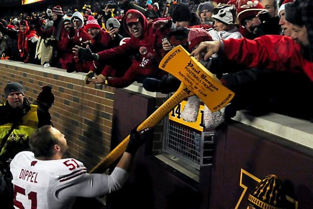 Wisconsin's DE Tyler Dippel runs around the stadium with Paul Bunyan's ax, after Wisconsin beat the University of Minnesota Gophers 20-7 at TCF Bank Stadium in Minneapolis on November 23, 2013. (Pioneer Press: Scott Takushi)