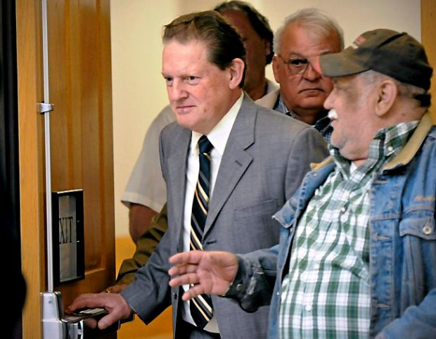 Byron Smith, center, comes out of a Morrison County courtroom in Little Falls, Minn., Monday, April 21, 2014, during a break in his trial. Smith shot and killed two teenagers who broke into his house on Thanksgiving Day 2012. Jurors began the process of deciding whether the killings were justified or whether the homeowner committed murder. Smith, 65, was convicted in the killings of Haile Kifer, 18, and Nick Brady, 17. (AP Photo/St. Cloud Times, Jason Wachter)