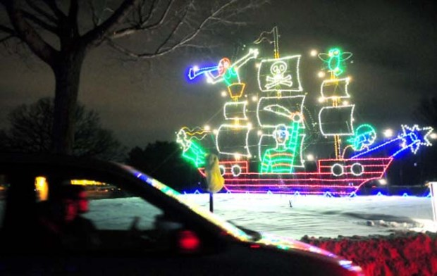 A car passes an enormous pirate ship that's part of the Holiday Lights in the Park at Phalen Park in St. Paul. (Pioneer Press: Ben Garvin)