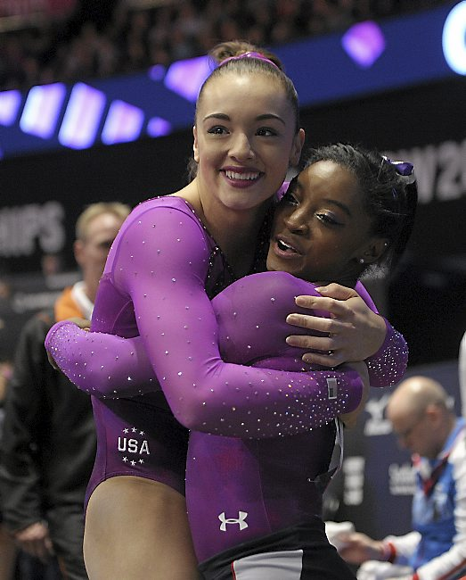Maggie Nichols, left, and Simone Biles will each compete for a spot on the U.S. Olympic team this weekend at the Olympic trials in San Jose, California (AP).