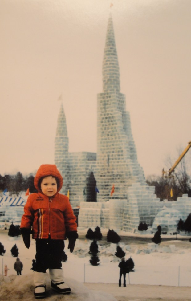 """Then & Now — or: Where we live ... Reports JOHN IN HIGHLAND: """"Can it really be 30 years since we had the Winter Carnival Ice Palace at Lake Phalen? No. 1 son posed in front of the 1986 structure. His uncle, Mike, was one of the workers who ran a saw to cut the ice blocks out of the lake. It was truly a 'St. Paul' structure with the ice harvested on site, not trucked in by Wee Kut Ice Co. from Spicer, as in 1992."""""""