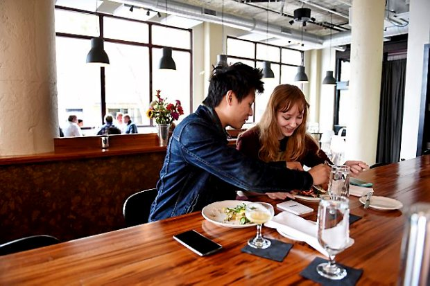 Elizabeth Haliburton and Dustin Nguyen enjoy breakfast at Lowertown's Saint Dinette on Sunday, August 23, 2015. (Pioneer Press: Sherri LaRose-Chiglo)