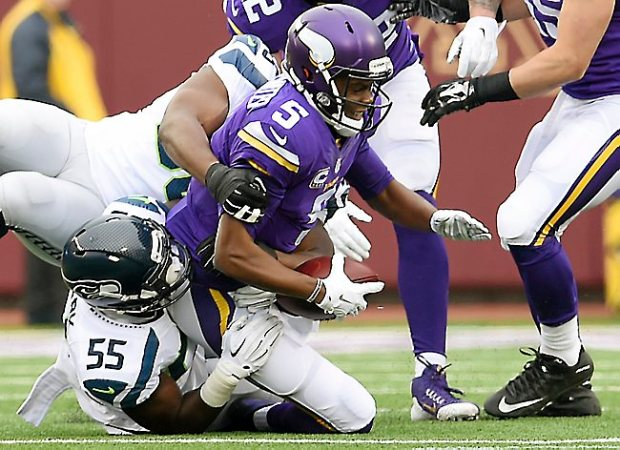Minnesota quarterback Teddy Bridgewater is sacked by Seattle defensive end Frank Clark in the first quarter at TCF Bank Stadium on Sunday, December 6, 2015. (Pioneer Press: John Autey)