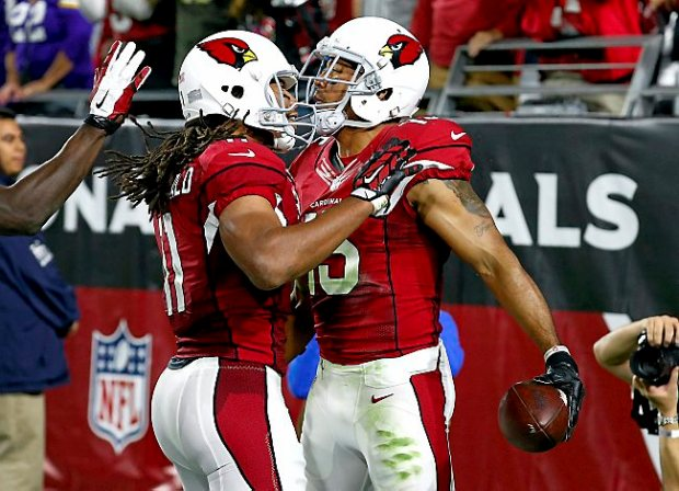 Arizona wide receiver Michael Floyd (15) celebrates after scoring a touchdown against the Vikings with fellow Minnesotan Larry Fitzgerald (11) during the second half of their game, Thursday, Dec. 10, 2015, in Glendale, Ariz. (AP Photo/Ross D. Franklin)