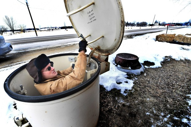 "Dennison, Minn., mayor Jeffrey Flaten climbs down to check the pumps in the city's sewer lift station on Wednesday, Feb. 10, 2016. ""This isn't something I'm trained in. It's been pretty much a hands-on experience."" (Pioneer Press: Jean Pieri)"