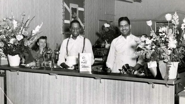 Undated photo from 1949 of Archie Givens, Sr., center, at the Givens Ice Cream Bar, which opened in Minneapolis in 1947. Photo courtesy of the Givens Foundation.