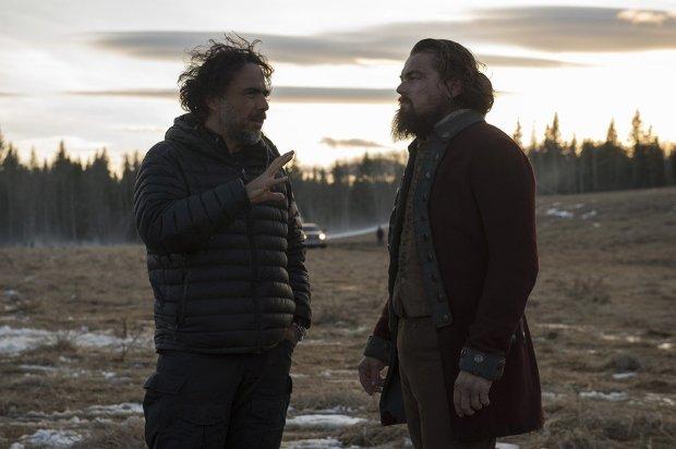 "Director Alejandro Gonzalez Inarritu, left, with Leonardo DiCaprio on the set of ""The Revenant."""