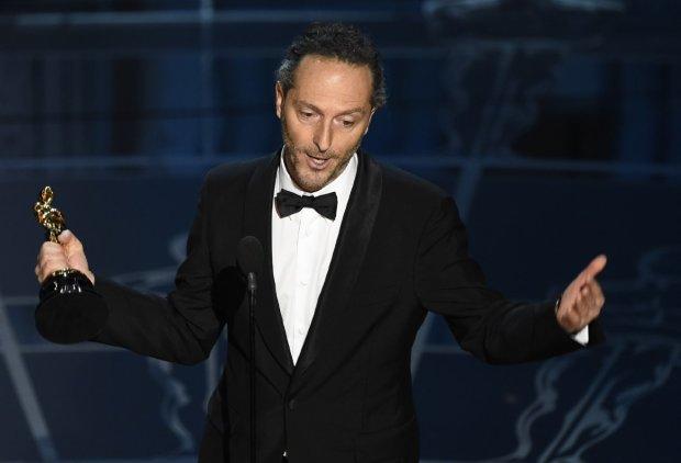"Emmanuel Lubezki picking up his Oscar for ""Birdman."""