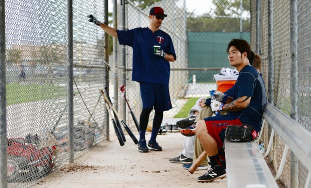 MInnesota Twins first basemen Joe Mauer and Byung Ho Park wait for their turn at batting practice at Minnesota Twins Spring Training at Hammond Field/CenturyLink Sports Complex in Fort Myers, Florida on Friday, March 4, 2016. (Pioneer Press: John Autey)