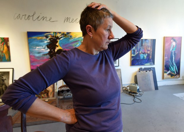 """""""We went through shock, depression and now are in panic. This is the third time it has happened to me,"""" says Caroline Mecklin, who paints and draws in the Jax Building in St. Paul's Lowertown and must now find a new studio space. She's photographed on March 1, 2016. (Pioneer Press: Scott Takushi)"""