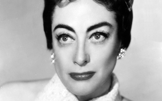 "The late screen legend Joan Crawford, shown in 1955, was born on this day in 1908. The actress known for her roles in the films ""Mildred Pierce"" and ""Whatever Happened to Baby Jane?"" died in 1977, and had a resurgence in popular culture a year later, with her daughter's tell-all bestseller about her mother's abuse, ""Mommie Dearest."" Faye Dunaway played Crawford in the movie. (Associated Press file photo)"