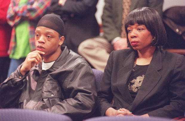 """In a January 1999 photo, Andre Coppage and his mother, Terri, listen in federal court as charges are unveiled against 22 suspects in alleged gang activity that included the 1994 fire that killed five children in the Coppage family. Robert """"Buster"""" Jefferson was the only one of the 22 indicted Friday to be charged with murder."""