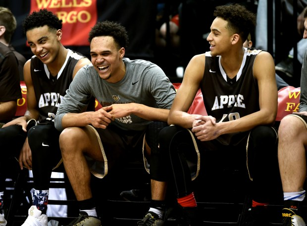 After building a large lead, Apple Valley starters, from left, Tre Jones, Gary Trent Jr. and Cameron Kirksey enjoy watching the game from the bench in the second half, as the Apple Valley Eagles beat the Blaine Bengals 77- 57 in the quarterfinal game of the Class 4A State Boys Basketball Tournament at Target Center in Minneapolis on Wednesday, March 9, 2016. (Pioneer Press: Scott Takushi)