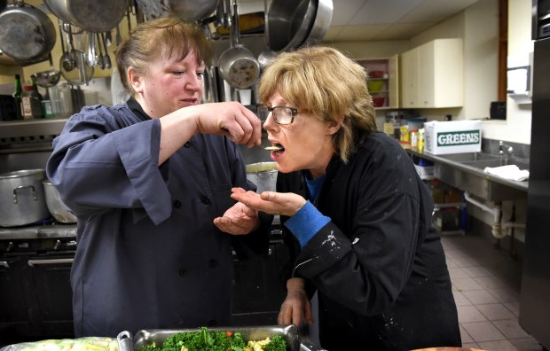 At 11:25 a.m., twenty minutes before serving food, Barb Westman, right, samples a spoon of salmon bisque soup made by sous chef, Sue LeClaire at Central Presbyterian Church in downtown St. Paul Wednesday, March 9, 2016. For 25 years Chef Barb Westman works with staff and volunteers to prepare the Wednesday lunch at Central Presbyterian Church. (Pioneer Press: Jean Pieri)