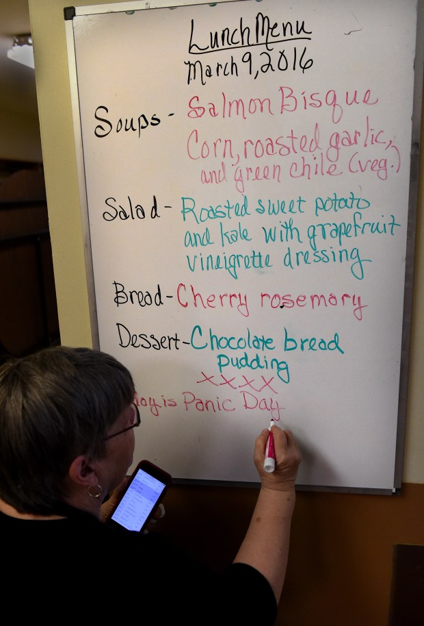 A volunteers writes the lunch menu on a board at Central Presbyterian Church in downtown St. Paul Wednesday, March 9, 2016. For 25 years Chef Barb Westman works with staff and volunteers to prepare the Wednesday lunch at Central Presbyterian Church. (Pioneer Press: Jean Pieri)