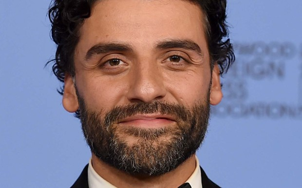 """Actor Oscar Isaac, who had the title role role in the Coen brothers' 2013 movie """"Inside Llewyn Davis,"""" is 36. (Associated Press: Jordan Strauss)"""