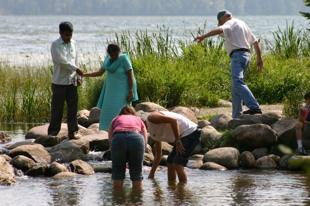 Visitors cross the headwaters of the Mississippi River at Itasca State Park on Sept. 10, 2005. (Pioneer Press file photo)