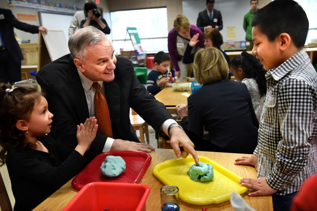 Gov. Mark Dayton, center, talks to Moises Bautista, right, and Andie Stachowiak about their playdough projects in their preschool class at Kaposia Education Center in South St. Paul on Thursday, March 31, 2016. Dayton visited two preschool classes and met with teachers, administrators and parents. (Pioneer Press: Jean Pieri)