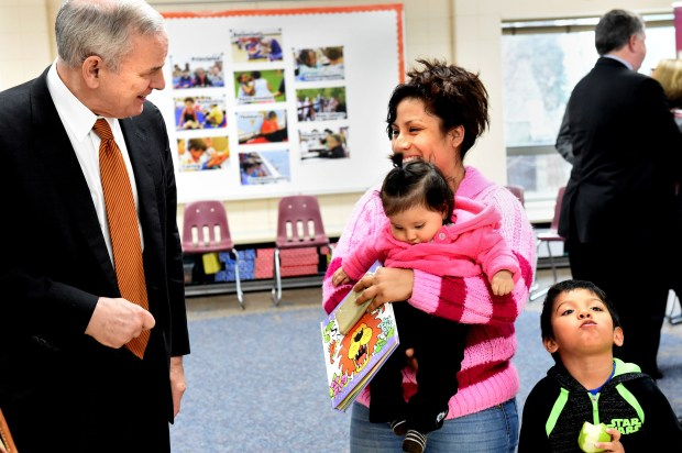 After a meeting with teachers, administrators and parents, Gov. Mark Dayton tells Gabriela Dressen that her children were well-behaved at Kaposia Education Center in South St. Paul on Thursday, March 31, 2016. Dressen spoke up in the meeting about how her older child (not pictured) had a hard time in kindergarten because he didn't go to preschool. With Dressen are Alex, 4, and Victoria, 8 months.  (Pioneer Press: Jean Pieri)