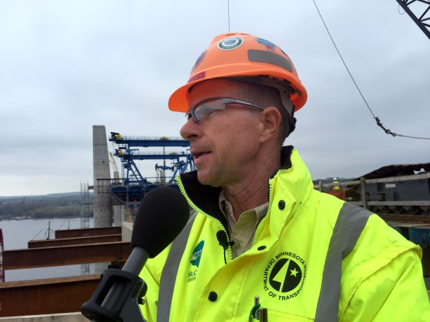 Paul Kivisto, the Minnesota Department of Transportation's bridge construction engineer, speaks during a preview the 2016 St. Croix Crossing construction season on Wednesday, April 20, 2016,. This photo was taken from the Wisconsin side of the river, looking east toward Minnesota. (Pioneer Press: Mary Divine)