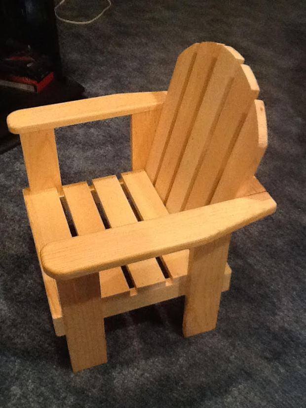 """Life as we know it ... Writes IGHGRAMPA: """"This is a child-sized chair I recently made from plans I found on the Internet. It turned out pretty well. It's an Adirondack-style chair. I made a few changes as I built it. The plans called for }-inch pine. I planed it down to 