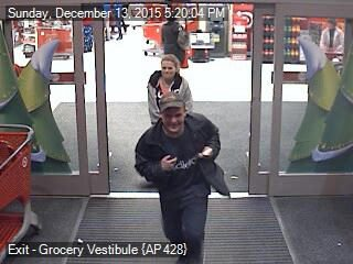 Surveillance video shows a man and a woman running from the Target store in Fridley after an accidental gunfire incident Sunday, Dec. 13, 2015. Seth Allan Millner of Mora, Minn., pleaded guilty to reckless discharge of a firearm April 12, 2106, in Anoka County District Court. (Photo courtesy Fridley Police Department)