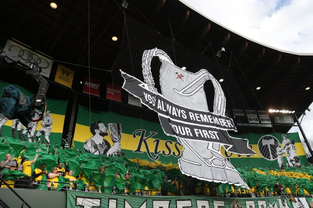 "Fans raise their tifo during pregame festivities at Providence Park in Portland, Ore. before the 2016 MLS season opening game between the defending champion Portland Timbers and Columbus Crew, March 6, 2016. A ""tifo,"" in soccer culture, is a sign of support. The Timbers Army, which made the signs, is considered a strong MLS ""supporters group,"" or fan club. Photo courtesy of The Oregonian/OregonLive: Thomas Boyd."