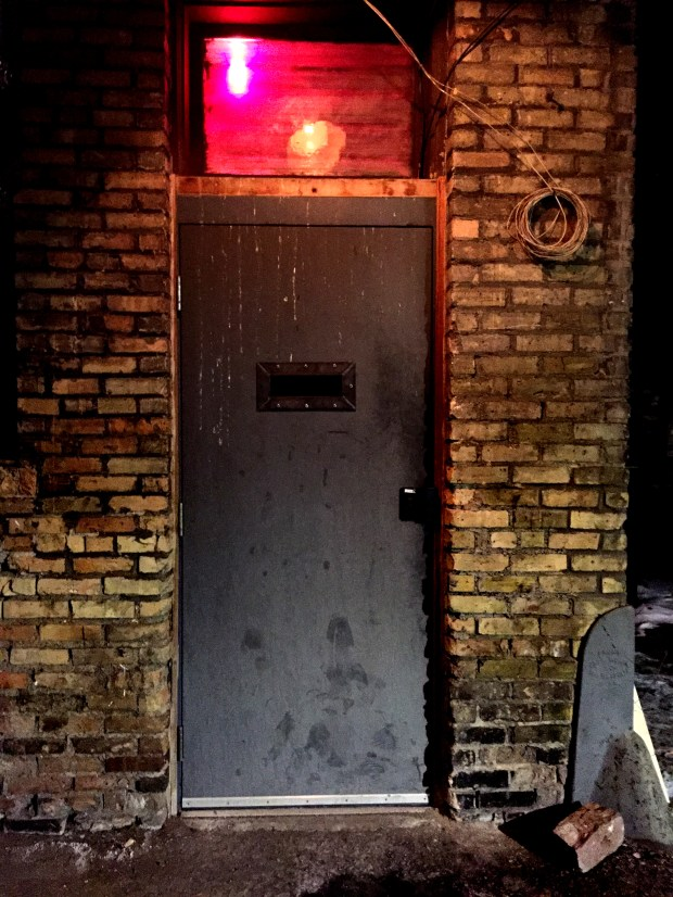 A red light lets you know you've arrived at the secret entrance to Volstead's Emporium in Minneapolis' Lyn-Lake area. (Pioneer Press: Nancy Ngo)