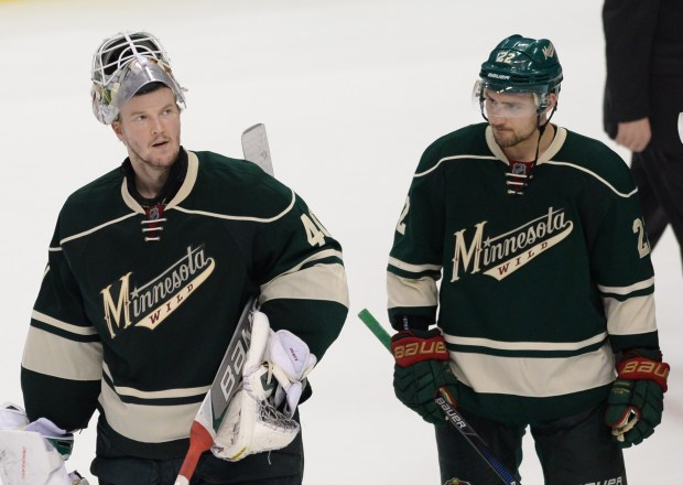 Minnesota goalie Devan Dubnyk and right wing Nino Niederreiter react to losing 5-4 to Dallas in game 6 of the first round of the NHL Stanley Cup playoffs at Xcel Energy Center in St. Paul on Sunday, April 24, 2016. (Pioneer Press: Holly Peterson)
