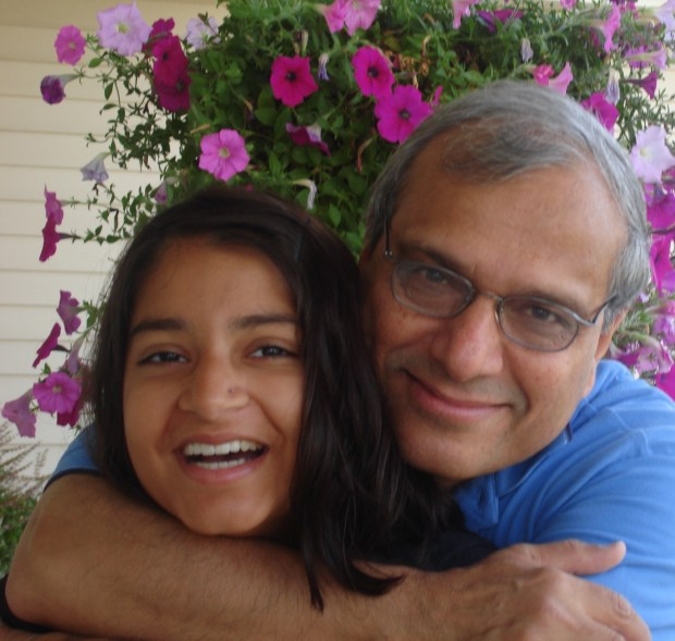 Vijay Dixit and his daughter, Shreya, outside their home in Eden Prairie on Aug. 26, 2006, just before he and his wife, Rekha, drove her to Madison, Wis., to begin her sophomore year. Seven weeks later she was gone. This was the last photo ever taken of father and daughter.